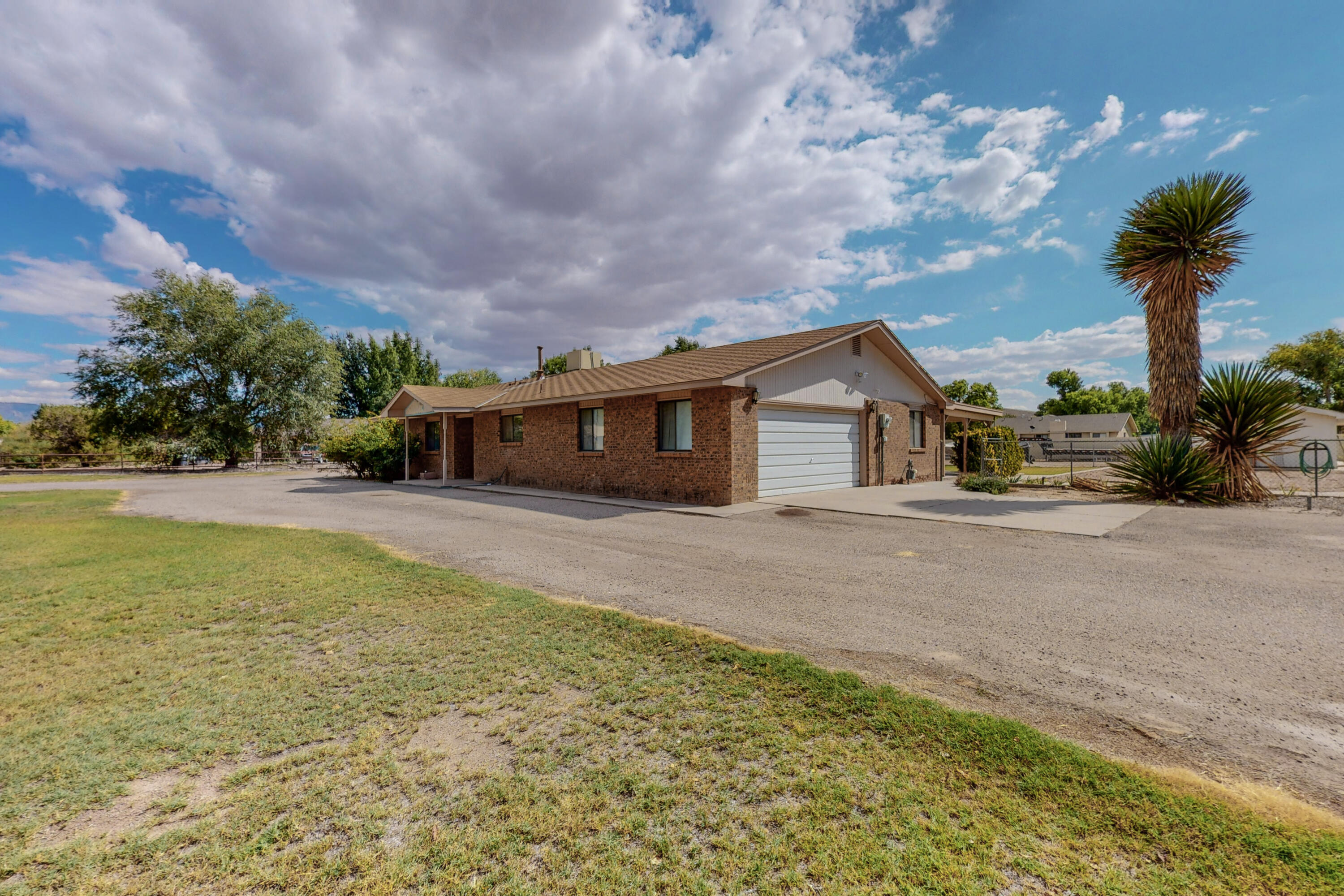 Open house Saturday 10/7 10am-1pm Offers received over the 1st 3 days on market will be reviewed Monday10/10 Nice solid brick veneer home. 3 BR 2BA large living area, office/bonus -room/possible 4th bedroom, large covered porch all on a very large 3/4 acre lot. Renovated kitchen with concrete counter tops and new cabinets. New tile in kitchen, living area and hall. Wet bar. Oversized finished garage has built in work bench and selves.  Backyard access at 2 points, RV parking possible, designated garden area, fruit trees, storage building, corner lot. This home has huge potential for the person looking to upgrade to something very nice. Come and see!