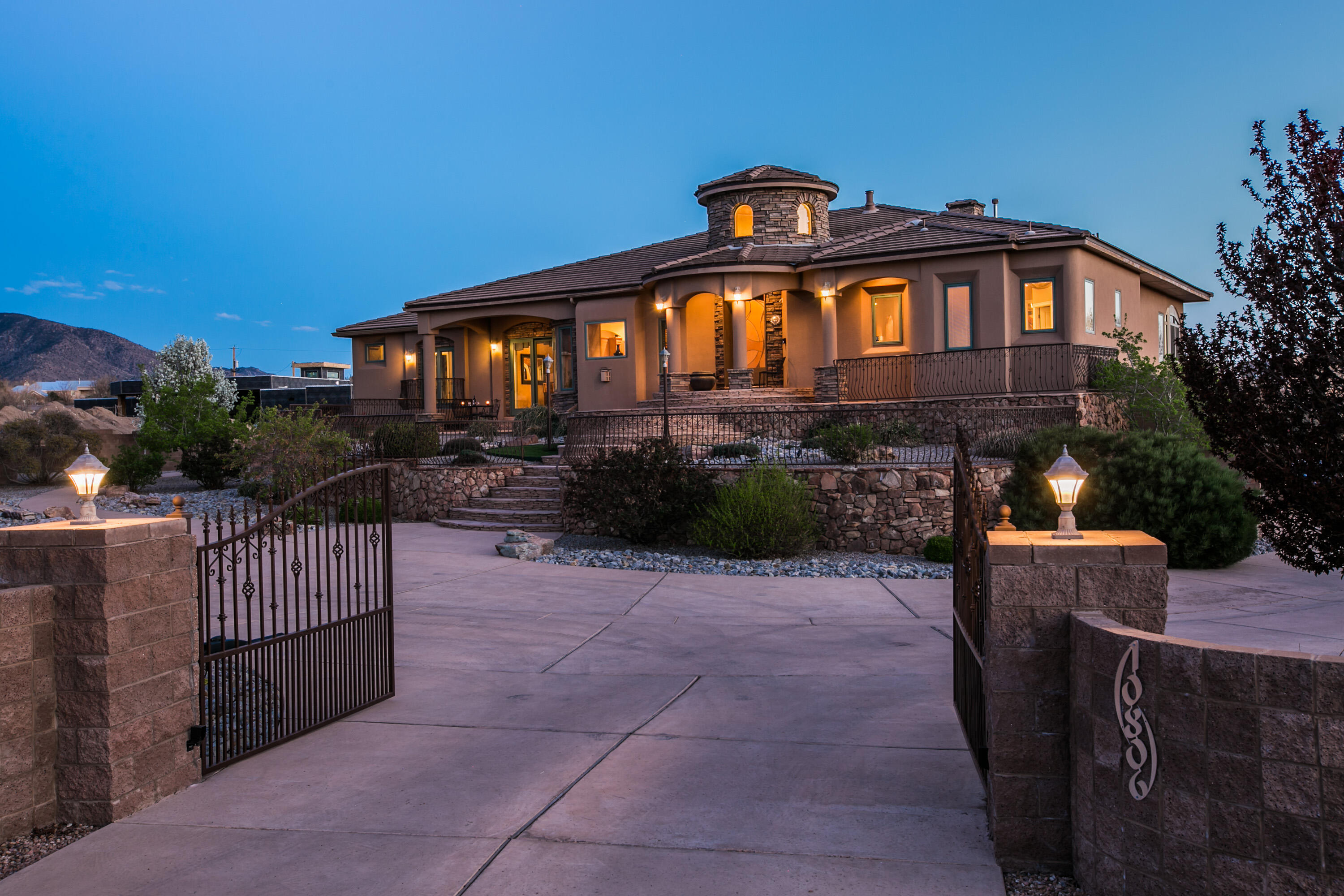 2005 Parade of Homes Winner, Lucero Custom Homes This impressive luxury home sits on a 1 acre, elevated lot with a beautiful gated entrance, overlooking the gorgeous Sandia Mountains and amazing city views. The gourmet kitchen with an oversized island overlooks the family and dining spaces with an open concept FP for entertaining. The large patio has been enclosed to maximize the entertaining space. Subzero/wolf appliances, plenty of storage and pantry space. 4 bedrooms, 4.5 bathrooms, office, downstairs walk out w/ family room, recreational room, exercise room and wet bar. The 3 car garage has an additional BIG storage closet! Blown in fiberglass insulation throughout including roof, Radiant heat, Ref Air, Pella wood windows, putting green, outdoor BBQ, Murals byJoy  LuxuryABQHome