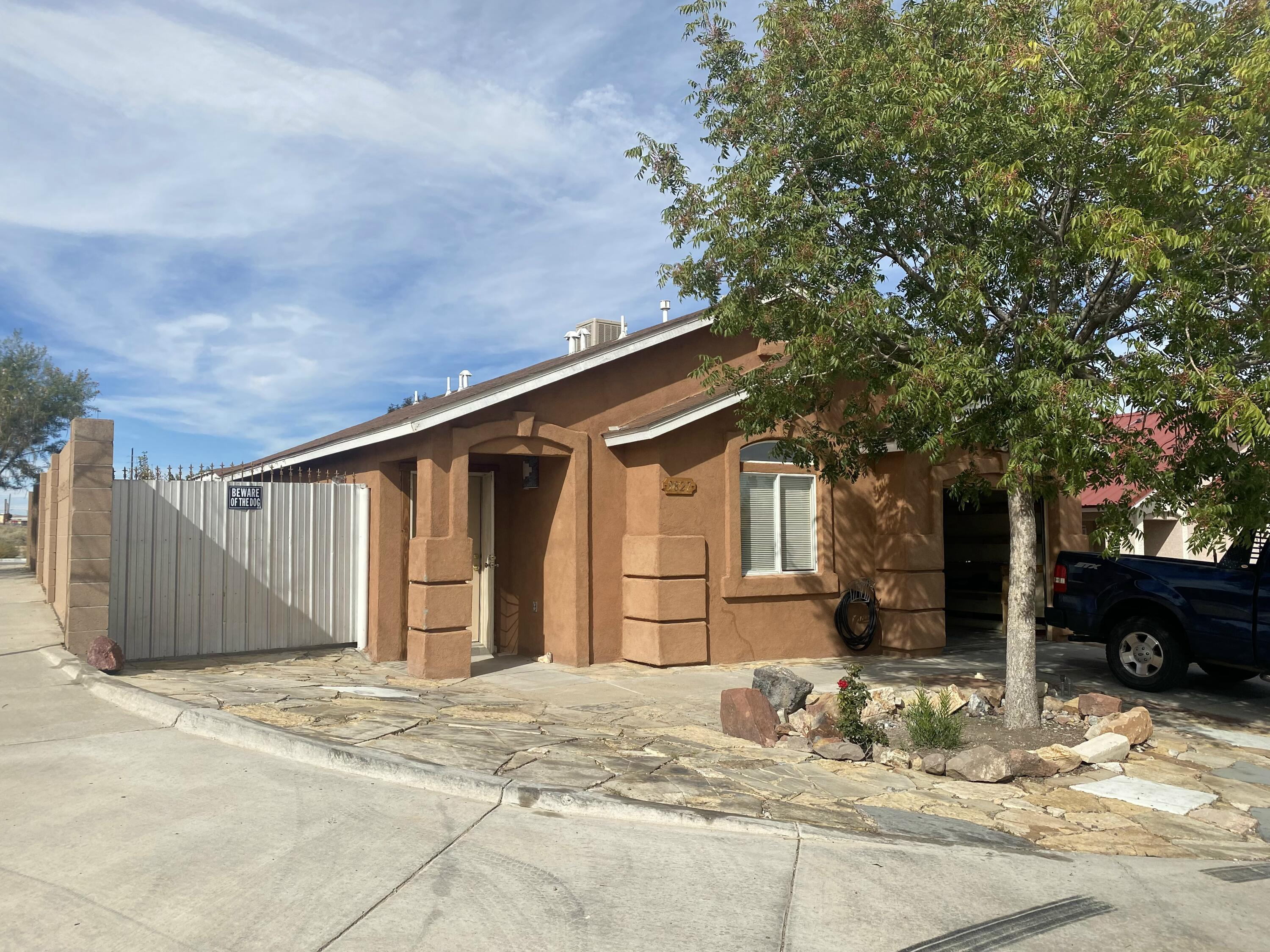 Corner Lot, front and back yard show pride of ownership flagstone throughout, mature fruit trees and amazing vegetable garden. Home features 2 big bedrooms, tile and laminate flooring and back yard access.