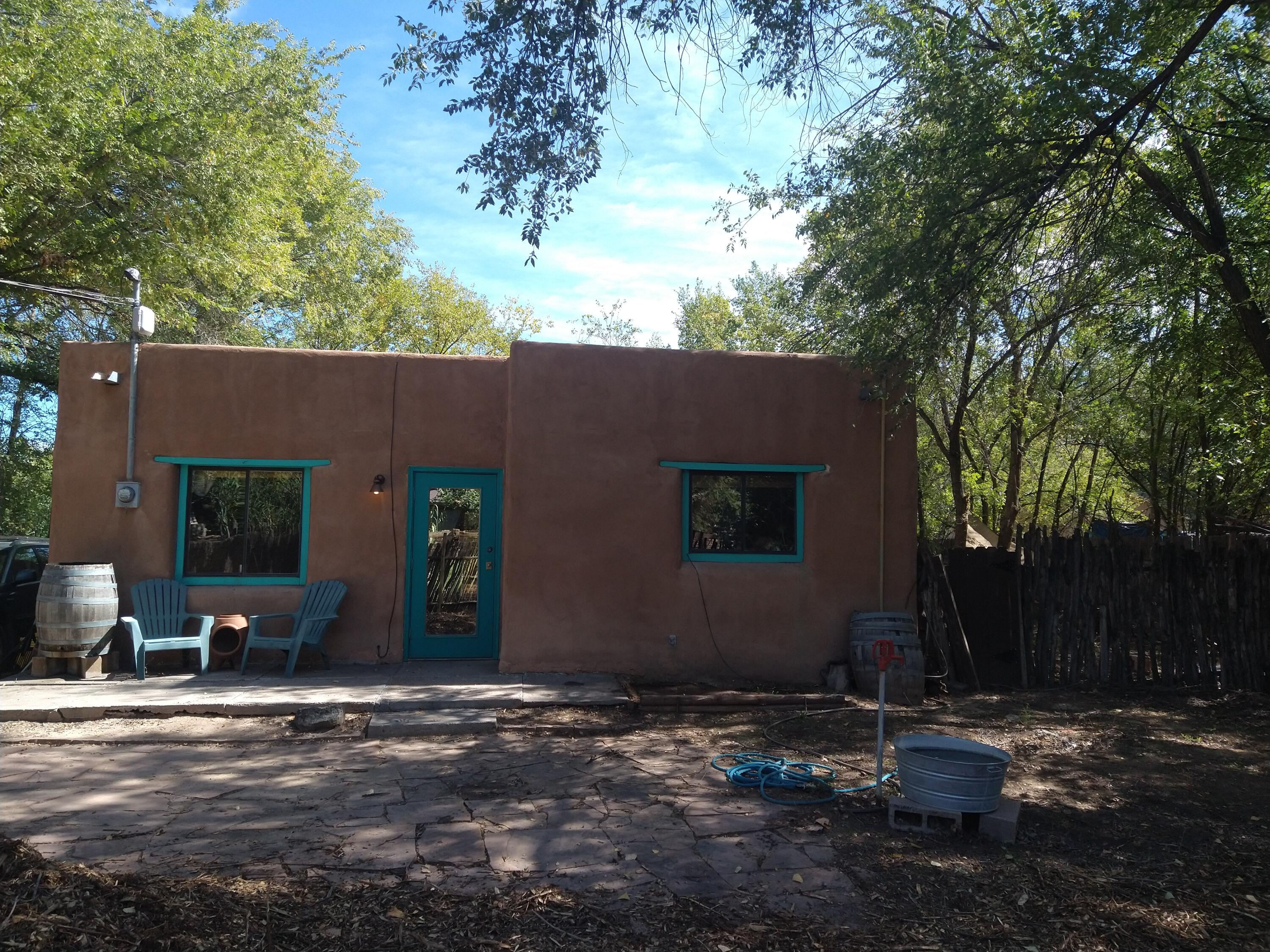 This home sold premarket. Placed in MLS for comparable purposes only. A charming, quintessential New Mexico home. Adobe construction sitting on a spacious lot with coyote fencing. With a deck built outback for your own personal yoga studio in the sunshine. This one is special.