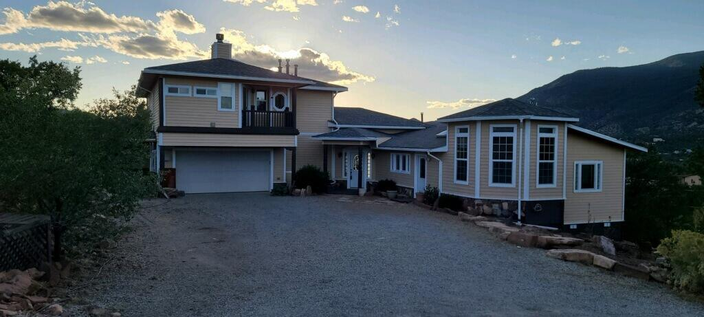 Open House Sunday 10/17 (12-2 pm). Beautiful spacious, custom mountain home with 270 degree views. Creative touches throughout. 3 Bedrooms, 2 baths, 4 car (tandem) garage. Large open great room, dining and kitchen. Kitchen has full range/oven and separate Teppan grill! 2 large bedrooms on lower-level with view deck. Hobby room, office,. Upper level master suite with sitting room and fireplace. Extra laundry area in master bedroom. Many view decks.  Oversized 4 car tandem garage with large workshop and storage. Beautiful outdoors to enjoy. Swim spa hot tub. Storage unit. Established garden area.