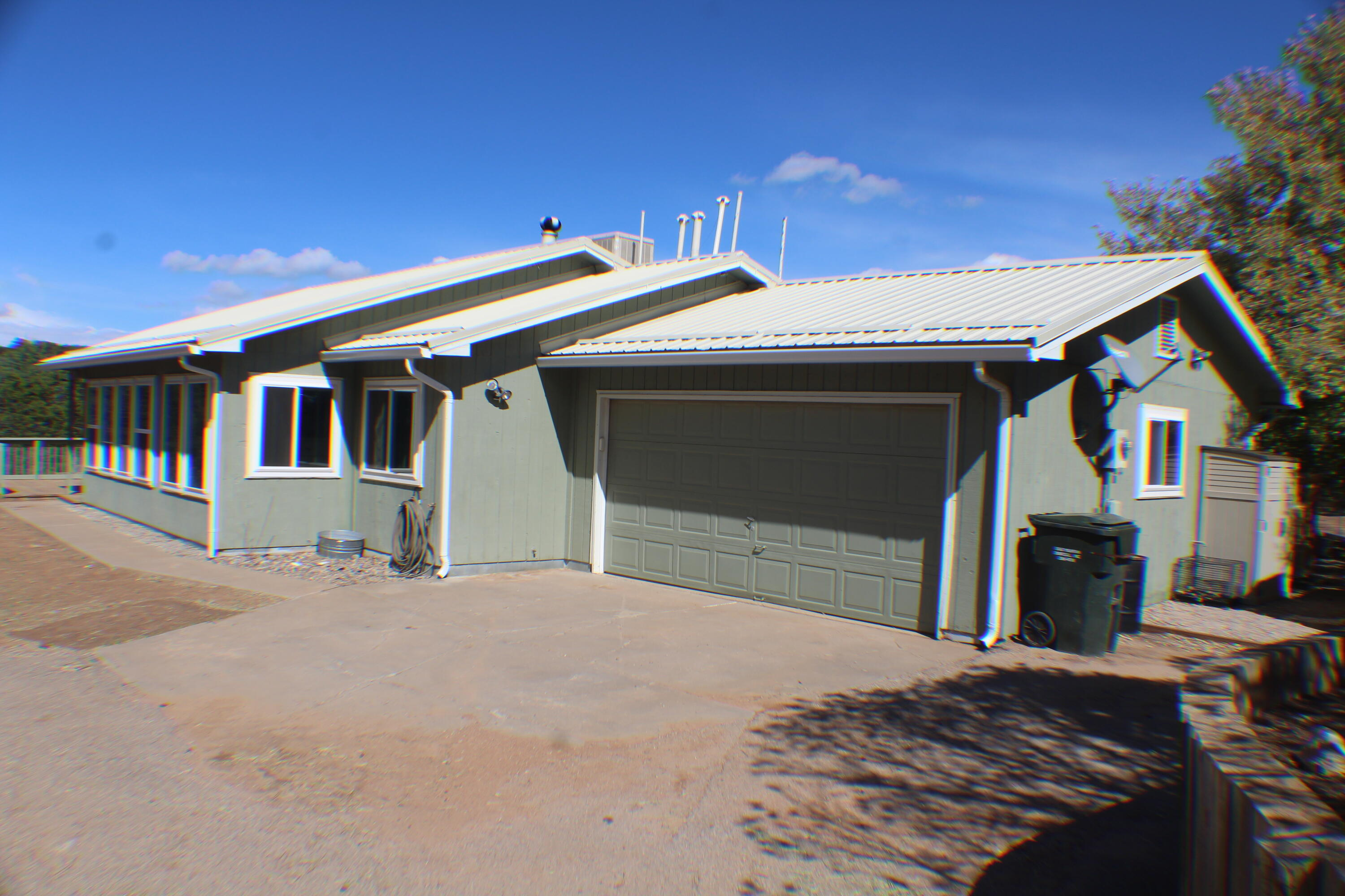 Fantastic home has new metal roof in 2019. New gutters and windows too. Recent paint throughout this home is ready for a new buyer. New range/oven and dishwasher. Upgraded lighting throughout. Fully fenced two acre lot has a detached garage that can hold 4 cars is 27x31. Pull down stairs for attic in detached garage. Gorgeous backyard has artificial grass and kids play area.Animal pens can stay if wanted.