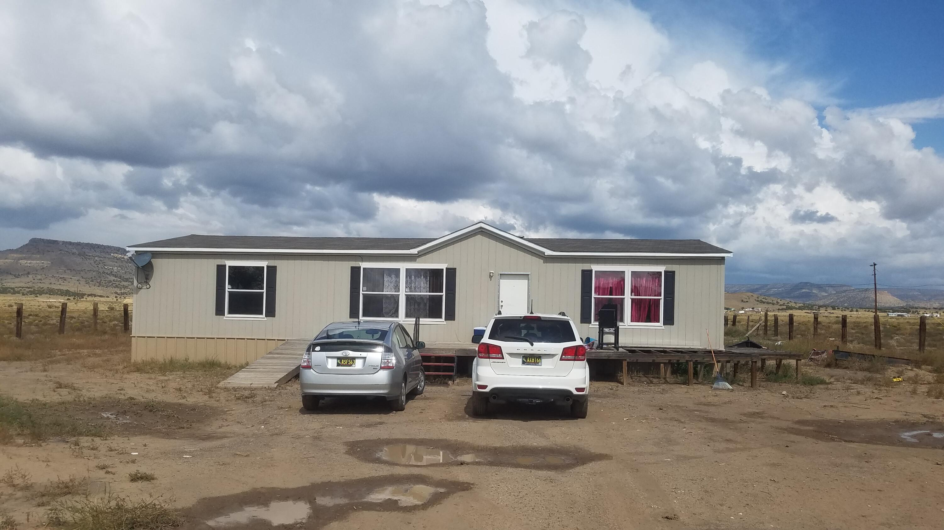 Newer mobile home and small restaurant, located on Old Route 66. Located 1 mile from sky city casino. Located on 3.55 acres, with nice views of Mount Taylor.