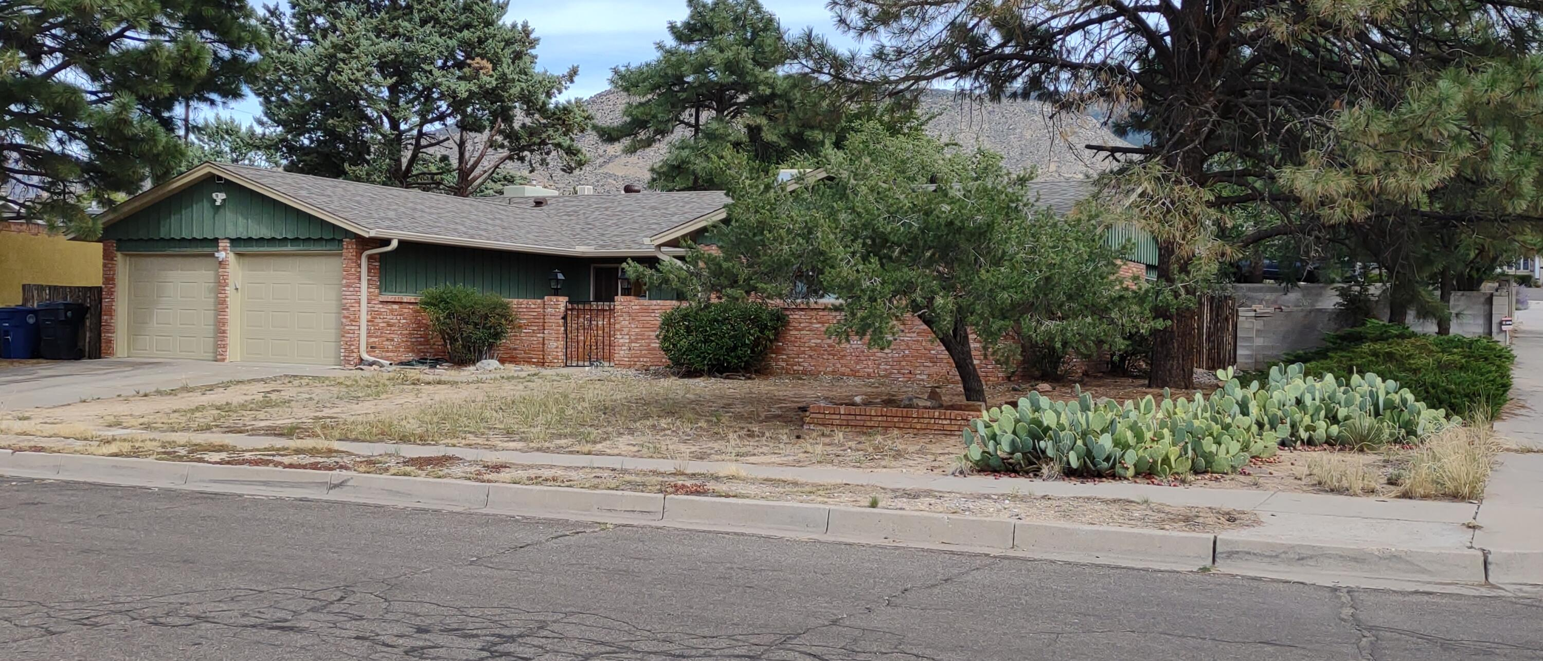 Great 1 story brick home nestled near the foothills. This wonderful home has 4 wonderful sized bedrooms, 1.75 bathrooms, 2 living areas, formal dining room and 2 car garage with openers. Improvements and upgrade are vinyl plank wood flooring, newer carpet, remodeled kitchen with updated appliances, cabinets,  counter tops, flooring and lighting. 2nd living room has wet bar, built in book shelves, brick wood burning fireplace. Don't miss the updated bathrooms, the large corner lot and all this little touches the seller has installed in the recent years.