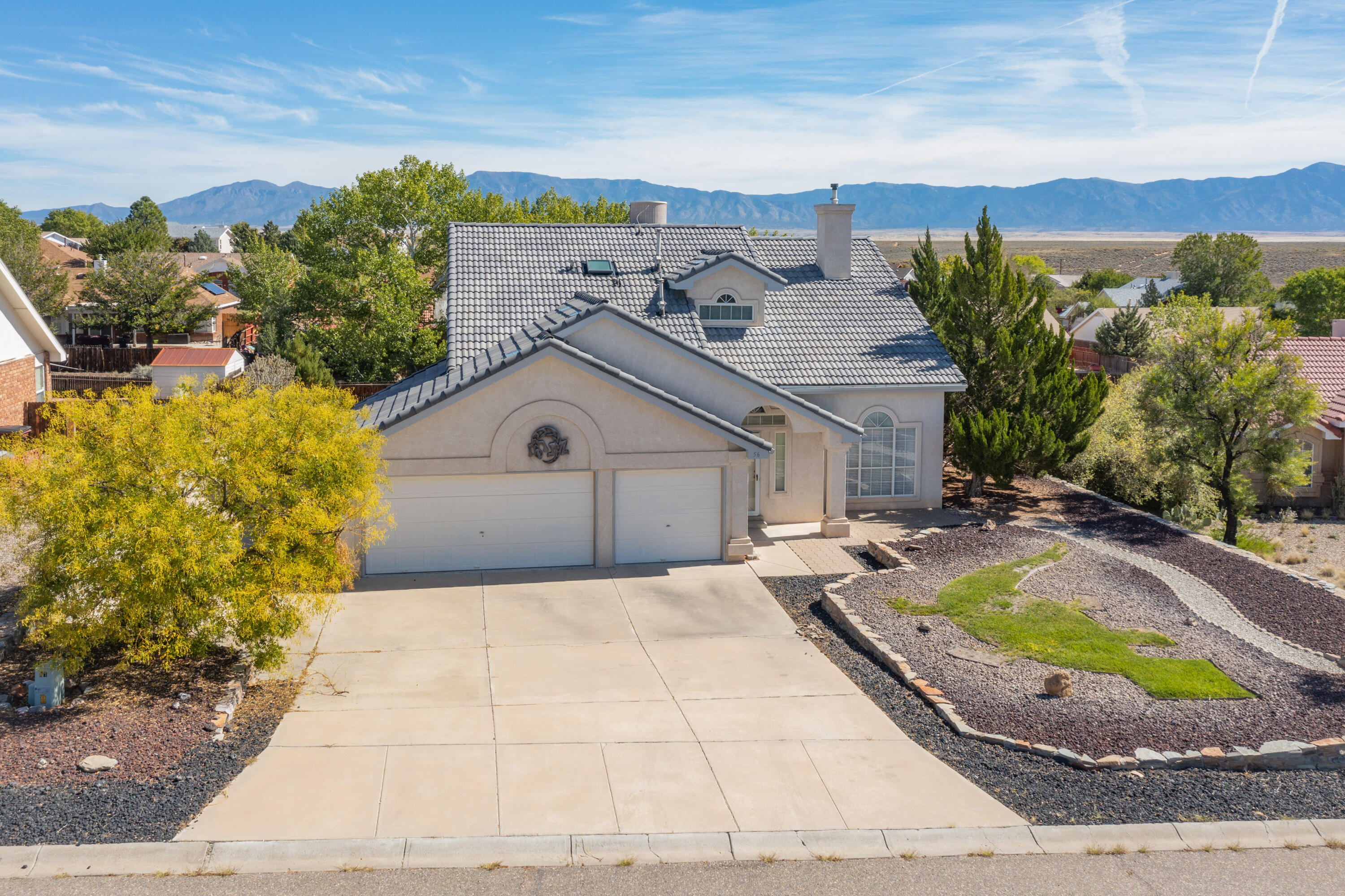 Beautiful and well-kept home in a desirable Los Lunas community with outstanding views of the Manzano Mountains. This custom home features 3 bedrooms, 2 1/2 baths, an oversized 3 car garage, high ceilings, a gas log fireplace, a sunroom, and a large loft with balcony to enjoy the sunrise. This property also includes completed mature landscaping in both the front and back yard. The home's coveted tile roof is only 7 years old and there are enough new tiles to roof a sizable outbuilding. The home also features a completely remodeled kitchen with all new Kitchen Aid Appliances including the fridge, microwave, dishwasher, oven & stove. This turnkey home will not last long, please bring your offers.