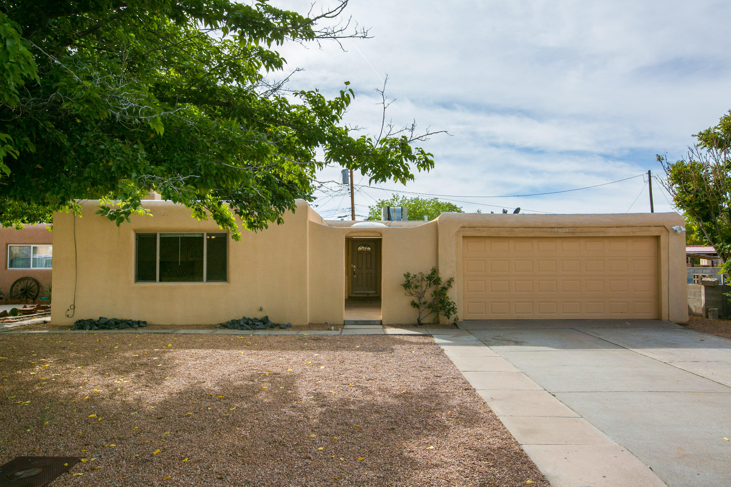 No HOA! This home is equipped with 3 bedrooms, 2 bathrooms, 2 living spaces, stainless steel appliances, kitchen island, custom tile surrounds and backsplash, upgraded vanities, terraced back yard with walled privacy and xeriscaped front yard. Home is selling as is.