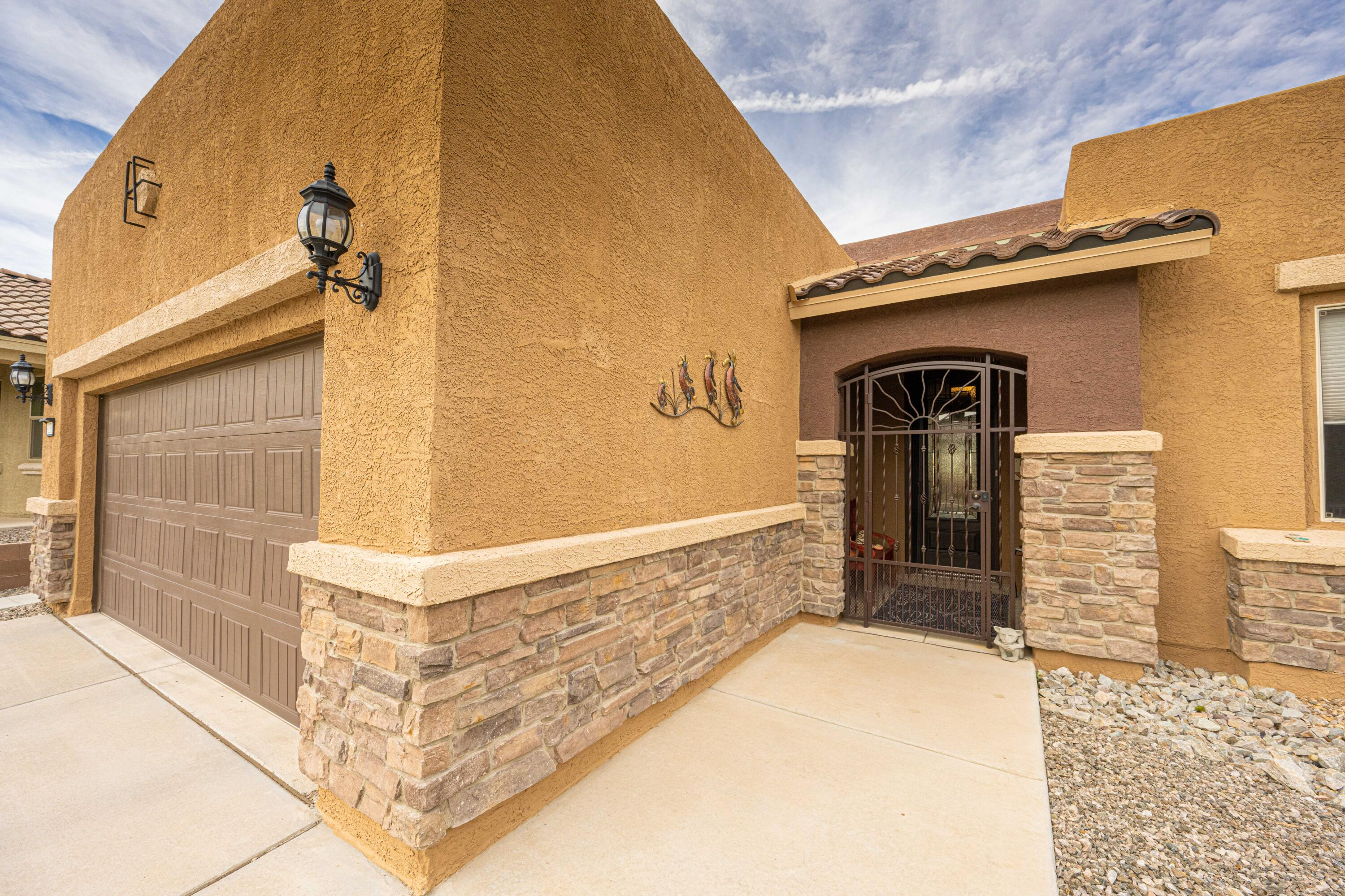 Beautiful Home in the Exclusive Del Webb Mirehaven 55+Community!! This 'Sanctuary' floorplan is approx 1835SF and sits on a large lot with some nice views of the Sandia's & Petroglyphs! Home offers 2BR's plus an office & Extended 4' Garage! Lux Kitchen Package has beautiful cabinets with pull outs, Gorgeous granite and back splash, Large Island with raised Dishwasher! Other Features include Gas FP, Bay Window in Master BR, Custom Gate Entry w/wireless doorbell, Custom Window Blinds, All Appliances incl Washer/Dryer and Refrigerator Stay, Large, low maintenance Custom Back Yard w/large covered patio & VIEWS! Low Utility Bills...Sun State Solar Panels! System is leased & new owner will take over lease.  Amenity Center offers daily activities, tennis courts, pickle ball, gym, salt water pool!