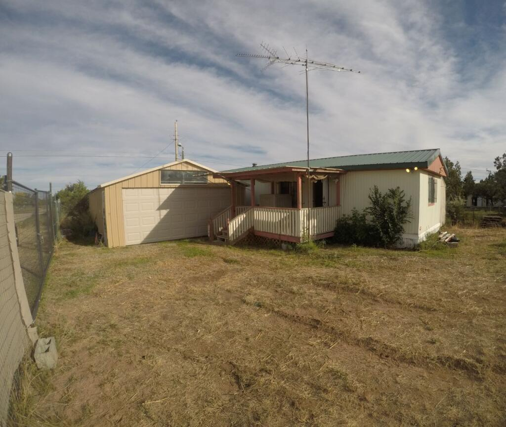*Sold As is* cash only offers please. This property won't last long at this price. A single wide MFH located in Mountainair NM needing a little tlc with a huge work shop ready for any hobby you might have. The work shop has electricity and a ventilation system already installed