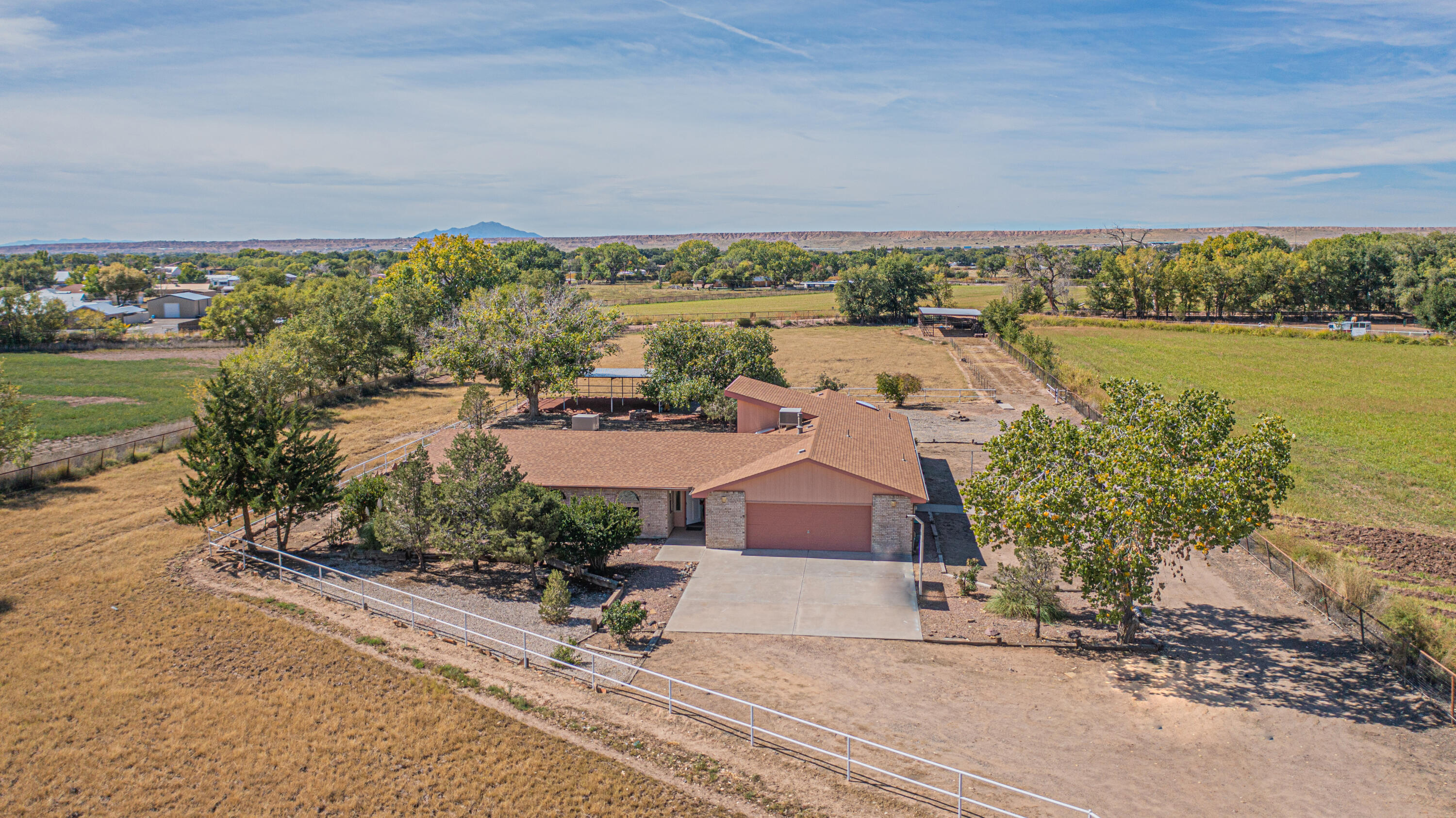 Newly remodeled home on 7.87 acres is ready for a new owner. Country living close to town. Big kitchen with granite counter tops, newer appliances and eat in kitchen with island has great views of the acreage and those NM sunsets. 2 living areas, separate dining room, office, 3 bedrooms and 2.5 baths gives you plenty of room for all of your family get togethers. You can always move outside to the covered area with firepit to enjoy our beautiful NM evenings with family and friends. Bring your animals, there's plenty of room for them too with pipe fenced corrals and hay barn. Home has 2 newer master cool units to keep you cool on those hot summer days and radiant baseboard heating (broiler was recently replaced) and a pellet stove for those cooler months. Don't miss this opportunity.