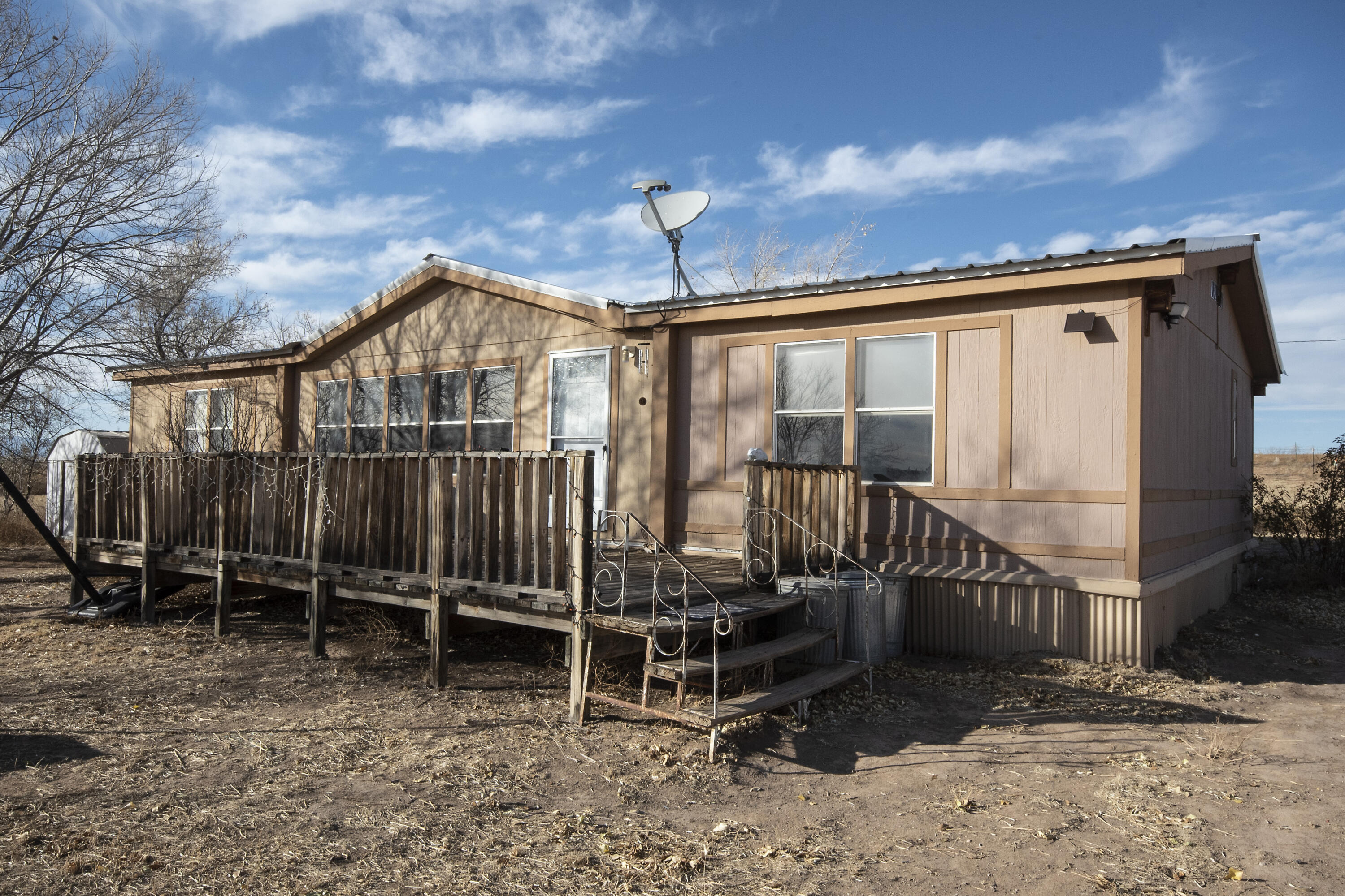 2 and a half acre fully fenced parcel with a 3 bed 2 bath 1676 square foot doublewide on a permanent foundation. Home was built in 1993, has two living areas, 2 full baths. Newer Septic system in the last three years, metal roof, nice open space, quiet country living!