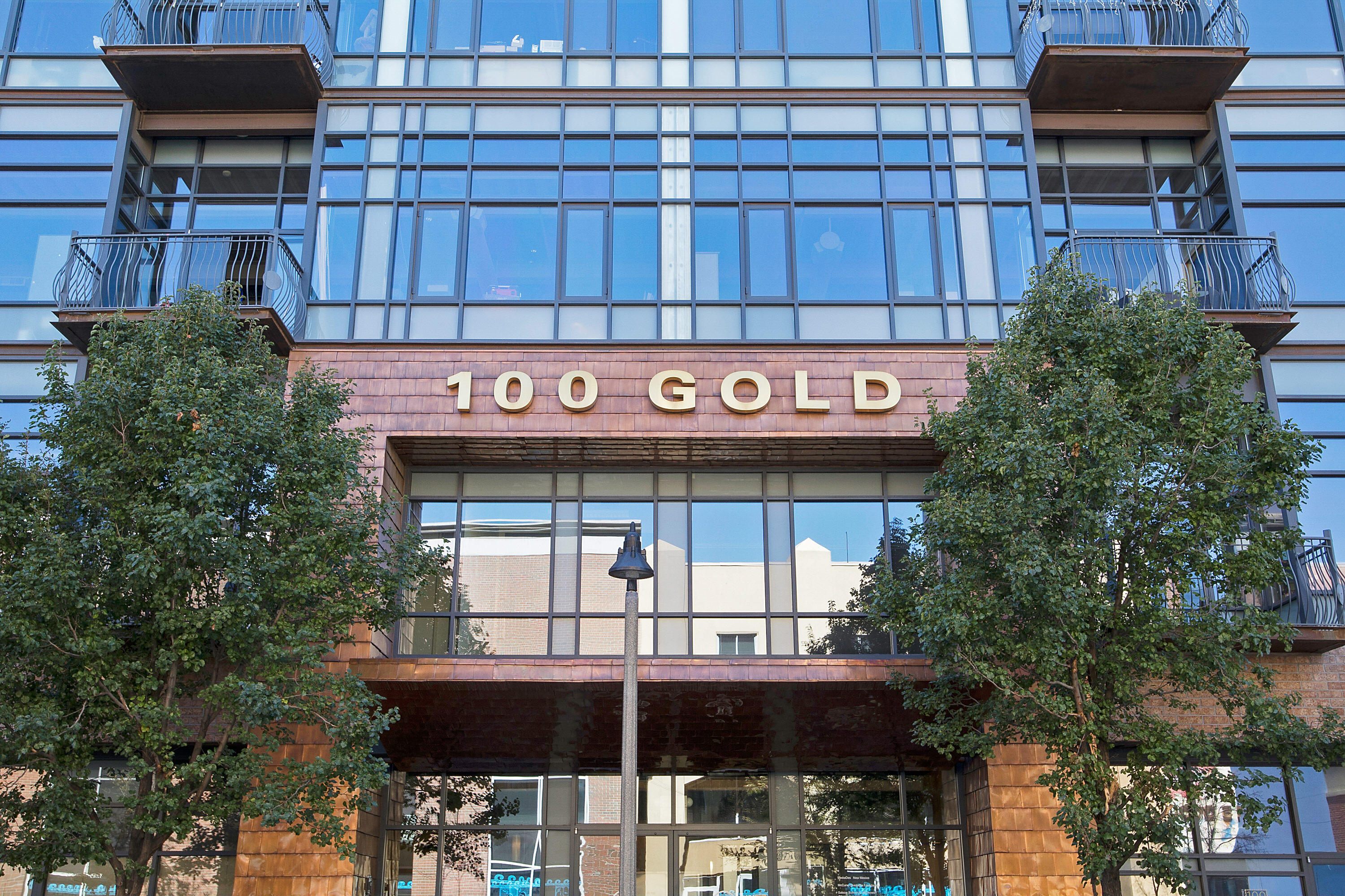 The 100 Gold building is a true gem in the Downtown Albuquerque cityscape. With convenient access to the movies, many dining options, and the Silver Street Market for groceries, everything you need is here! You will adore the high ceilings in your condo, with plenty of natural lighting pouring in from the northern and western high windows. On your private balcony, the views of downtown will blow you away. Your corner loft has a special Live/Work Designation, meaning your life AND your business can thrive! The unit features bamboo flooring, a modern kitchen with bar, stainless appliances, modern design touches, and a spacious north-facing bedroom. The building is securely accessible with a FOB, and each unit has one fully secured, covered, gate-protected parking spot.