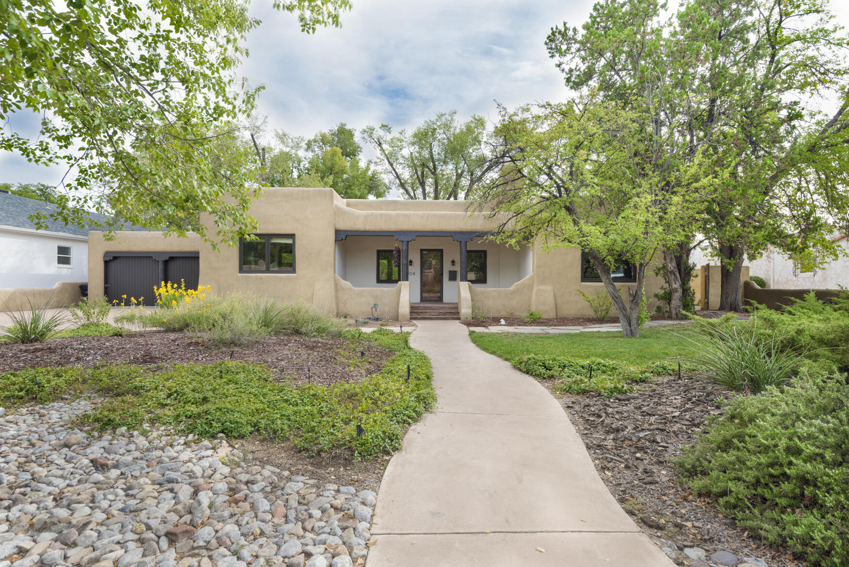 Truly spectacular Pueblo Revival home in the heart of Albuquerque's Ridgecrest neighborhood. The vintage charm of this house has been meticulously restored and combined with modern fixtures and amenities that have been carefully selected to enhance the original character of the house. The gracious living room features white oak floors, a beautiful kiva fireplace resting upon a flagstone hearth, dramatic original viga and latilla ceiling and French doors that open to the park-like backyard. The Kitchen offers custom wood cabinets, engineered stone tops, stainless appliances. Pella wood clad windows with custom shades are installed throughout main level. The double lot boasts incredible landscaping with mature trees, verdant lawn, large brick patio plus deck. Near UNM, Nob Hill & Bandelier!