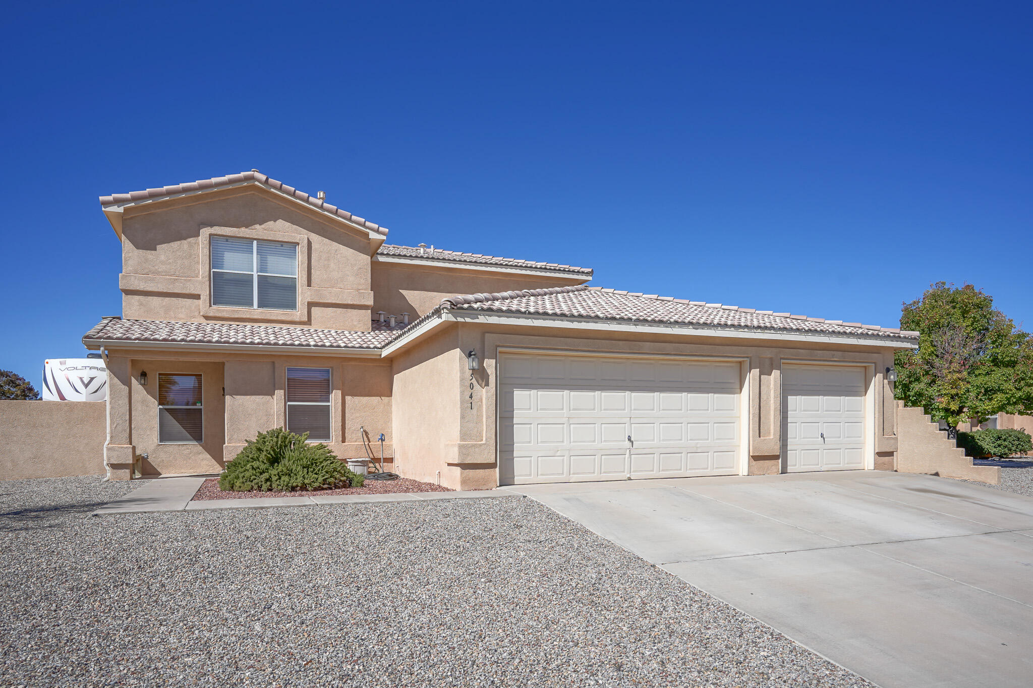multiple offers received! Must-see two-story home with a pool situated on a large corner lot in Rio Rancho! Open Floorplan, bonus loft space, Spacious backyard with large covered patio space, room for an RV, and backyard access. Private in-ground swimming pool with waterfall feature! The private owner's suite is located on the main floor and features French doors, a separate shower, a soaking tub, and a large walk-in closet. The open kitchen is perfect for entertaining as it looks out into the Living room and dining area! Three Car Garage! Quick access to 550 and the town of Bernalillo! Escape for a day trip or weekend away to Jemez Springs, only 44 minutes away! Take a virtual walkthrough tour today, or schedule a private showing!