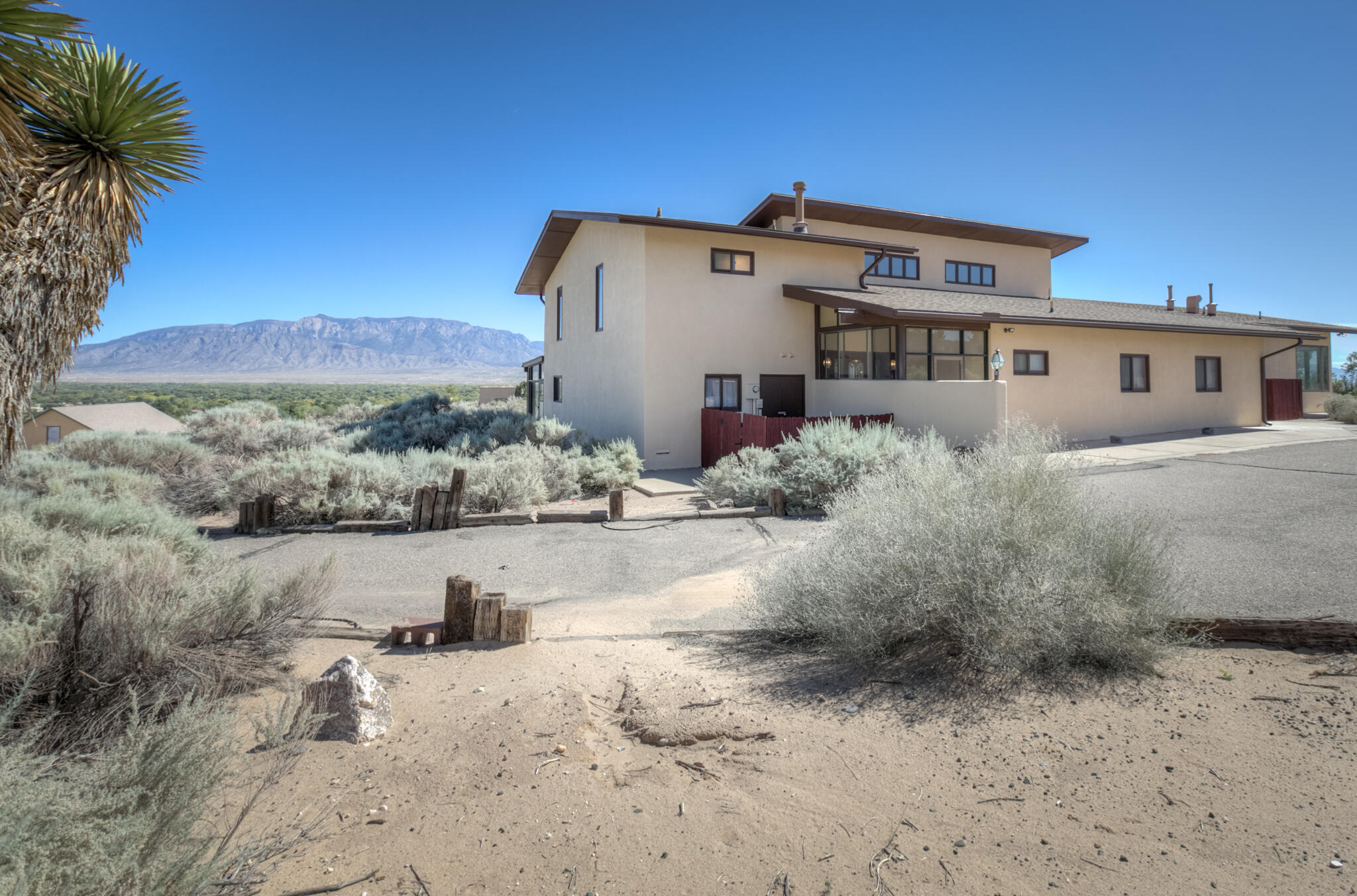 Absolutely stunning VIEWS of the Sandias, Santa Fe & Downtown from this custom built Corrales property!  Situated on 1+ acres and features: Huge great room w/ cathedral ceilings, wet bar & wood burning stove, Large kitchen w/ new double ovens & cooktop, desk, island & pantry, Owner's Suite w/ balcony & gorgeous views, Spacious 2nd & 3rd bedrooms, Massive in-law suite or hobby room w/ wet bar, full bath & separate entrance, Custom oak cabinetry, Picture windows, New well in 2020, Refrigerated air AND an amazing, oversized 4 CAR GARAGE w/ a bathroom & storage/tool room in addition to a Carport.  Don't miss this one!!!