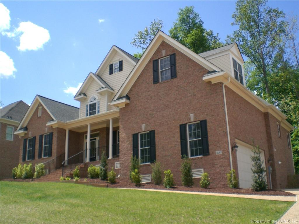 BEAUTIFUL ALL BRICK 2 STORY CUSTOM HOME WITH 2 CAR GARAGE AND PAVED DRIVEWAY. LOCATED IN POWHATAN SECONDARY. IN THE COLONIES NEIGHBORHOOD.TWO MASTER BEDROOMS WITH PRIVATE BATHS. ONE ON EACH FLOOR LEVEL. JETTED TUB IN MASTER BATHROOM DOWNSTAIRS ALONG WITH DOUBLE VANITIES. DREAM SIZE EAT IN KITCHEN WITH GRANITE/STONE COUNTER TOPS. A ISLAND. GAS STOVE.  PANTRY. RECESSED LIGHTING.  BAY WINDOW. BUILT IN CABINETS IN THE GREAT ROOM WITH TREY CEILING. FRENCH DOORS TO OFFICE AREA ON FIRST FLOOR. FORMAL DINING ROOM. WALK IN LAUNDRY ROOM. SCREENED IN PORCH OFF BACK OF HOUSE OVERLOOKING PRIVATE BACK WOODED YARD. GAS FIREPLACE. WALK IN ATTIC. IRRIGATION SYSTEM. DECK WITH GAS GRILL CONNECTION.FENCED IN PRIVACY BACK YARD.
