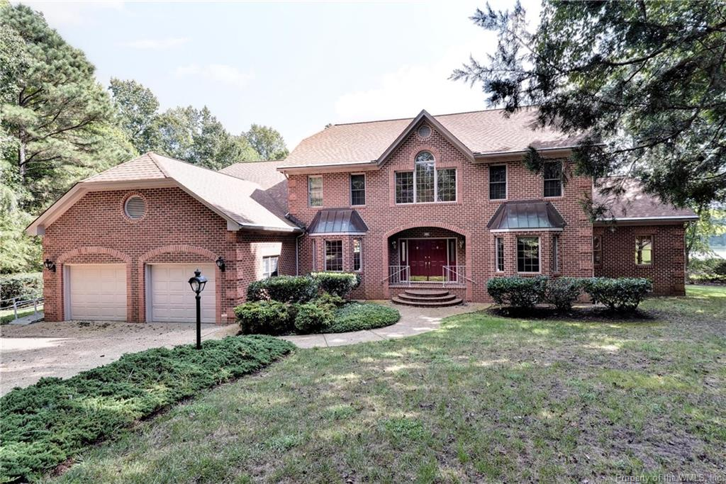 The VERY BEST VALUE in Ford's Colony!! Offering exceptional views of a beautiful pond and the 13thhole of the Blackheath golf course, this is an impeccably maintained, quality-built all-brick home you will love. Featuring 4,338 sq ft, there are 4 very spacious bedrooms, a charming sunroom, oversized 2-car garage plus workshop and hardwood flooring throughout. Light & airy great room offers fireplace, golf views and access to the deck. Just adjacent, the expansive kitchen features NEW granite & NEW appliances, crisp white cabinets, walk-in pantry & a breakfast bay accented by water & golf views plus a charming sunroom. DR and LR both feature bay windows. Generous MBR with gorgeous views, 2 huge walk-in closets  plus en suite bath. Upstairs there are 3 additional large bedrooms with BR 4 offering an office or 'flex' space. Additional details: Great utility rm w/storage and sink, walk-in attic storage, central vacuum, cedar closet.