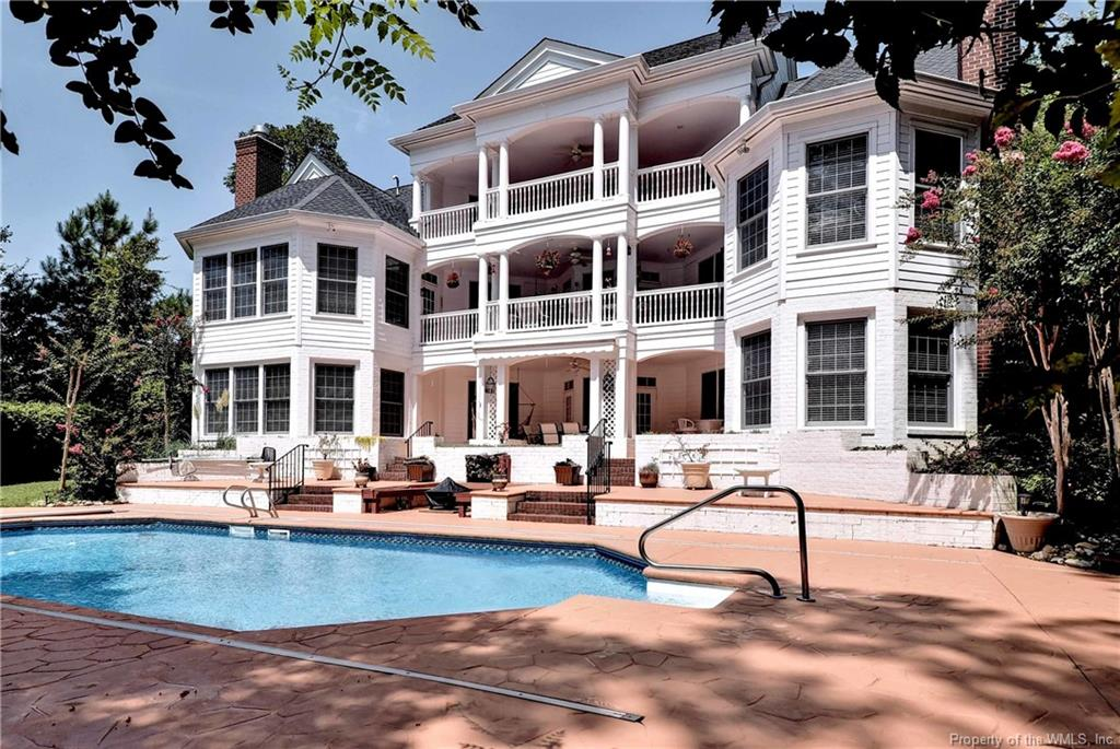 The essence of luxury and comfort. Private drive, charming entry, spacious interior (4,322sf on first and second floor), extended family living opportunities (1,776 sf walk-out lower level), and an exceptional outdoor living space.  Built in 2000 the residence was designed with plenty of room to accommodate family (large or small), as well as, friends who stay for one or many nights. The main level offers an open Family Room and Kitchen and a Master Suite complete with fireplace. The second floor offers a Library Loft, and 3 En-Suite Bedrooms. A second level Bonus Room, accessed by a second stair case, offers full bath and mini Kitchen. The walk-out lower level is perfect for multiple uses and lifestyles. Included are an In-Law Suite with fireplace and full Bath, Hobby Room, wine storage room (not conditioned), work shop, and storage area. Provisions are in place for a future elevator from the Lower level to the main floor, framed out with electric and telephone wiring. The outdoor living component is highlighted by covered verandas on three levels with striking views of the salt water pool, golf course, and pond.  5 En-Suite Bedrooms, 3-car garage, and still more!