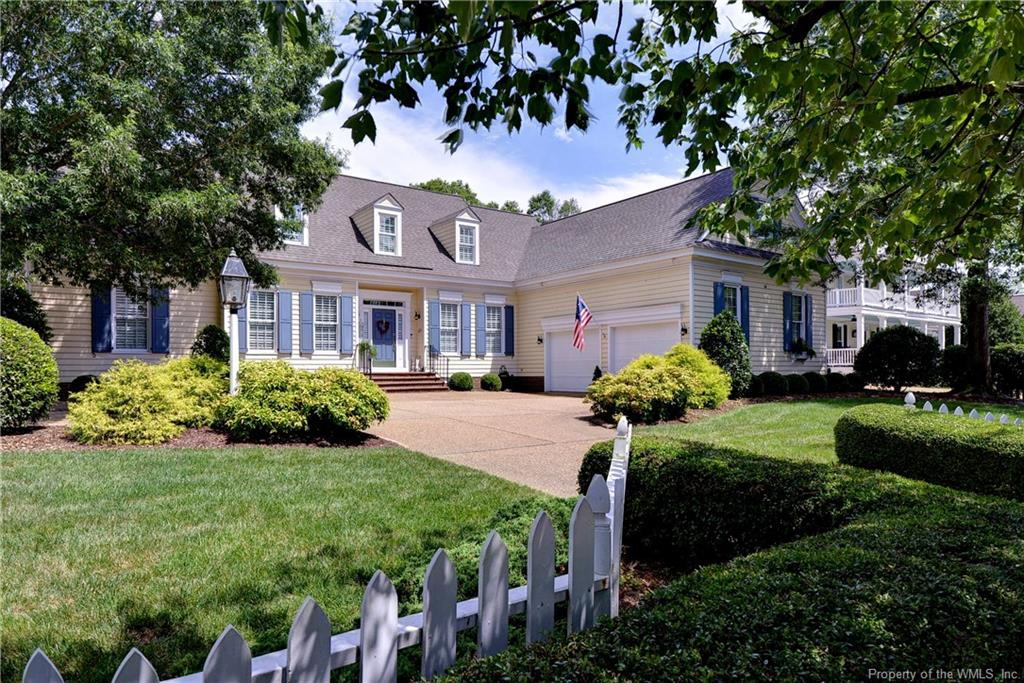 Imagine coming home to a charming neighborhood with white picket fences, brick paver sidewalks, mature trees lining the road, and a waterfront William E. Poole designed Cape Cod home. Imagine waking every morning and ending everyday overlooking a charming protected marina and the James River from your own bulkhead or deck.  Imagine no more.  Welcome to 1572 Harbor Road!  Sited in the private marina and  golf community of Governors Land at Two Rivers, in its quaint Marina Village, the property offers a superb waterfront lifestyle like no other!  A cozy interior includes a center hall flanked by formal Dining and Living Rooms. Overlooking the scenic marina are a two-story Great Room, updated eat-in Kitchen with new appliances, 1st floor Master Suite, and the 3 Season Room.  The 2nd level offer three En-Suite bedrooms, a Jr. Office/Exercise Room, and a large Bonus Room with built ins. Additional features  include  new 2016 roof, 2019 encapsulated crawl space, replaced HVAC units, 2018 whole house  natural generator, an oversized 2.5 car garage, and new planation shutters on the front of the house. Carefully maintained, beautifully sited, and ready for its next owners! Don't wait.