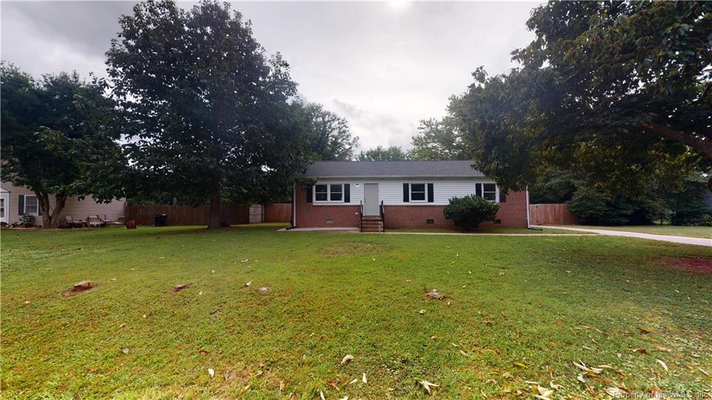 Come see this 3 bedroom 2 bath rancher located in Poplar Hall Plantation. Only minutes away from interstate access, shopping, Colonial Williamsburg, Busch Gardens and more. This homes has been remodeled to include new flooring in the kitchen, new roof, siding, and a finished basement. This property provides any dog owners a completely fenced in backyard, includes a detached 2 car garage, and a renovated loft / studio space above the garage. Come see everything this home has to offer today.